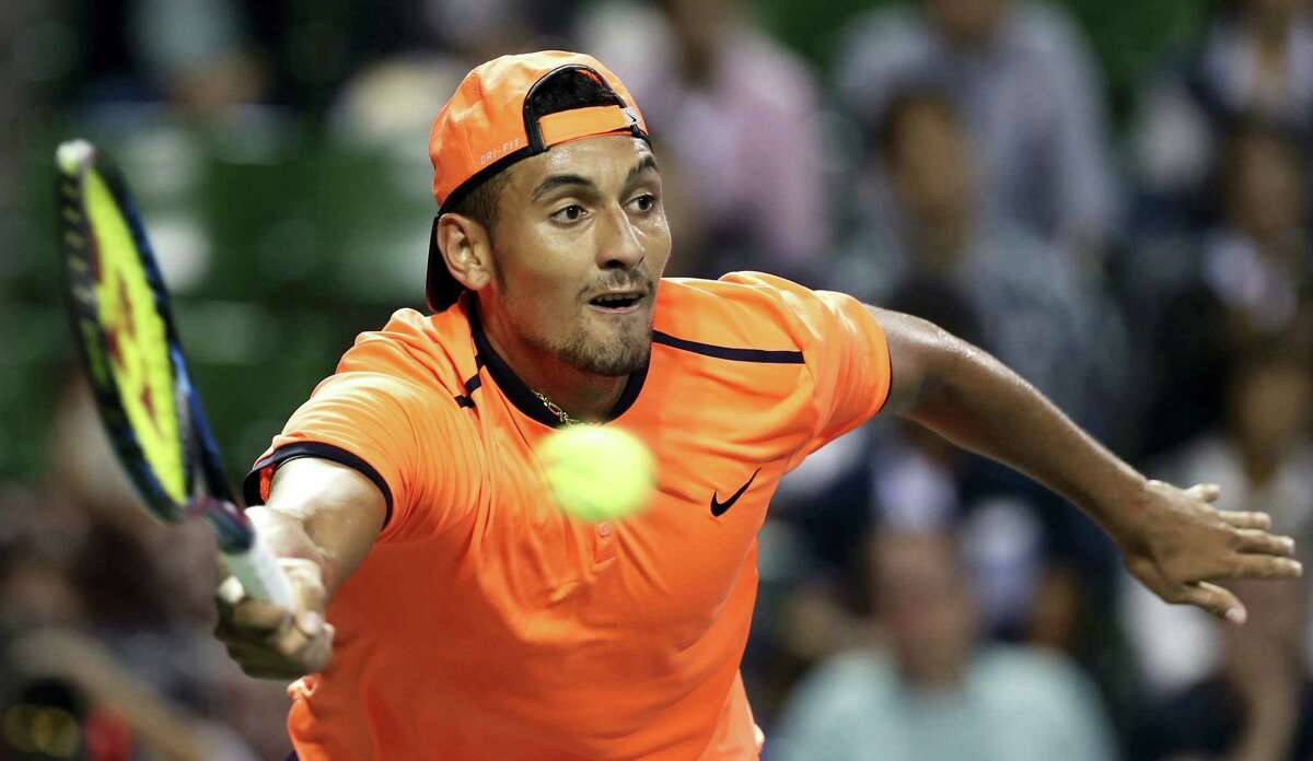 In this Oct. 8, 2016 photo, Australia's Nick Kyrgios returns a shot to Gael Monfils of France during the semifinal match of Japan Open tennis championships in Tokyo. Major champions Juan Martin del Potro, Venus Williams and Garbine Muguruza are among the tennis players taking part in exhibition matches at Madison Square Garden on March 6. Also participating: recently suspended top-15 player Nick Kyrgios.