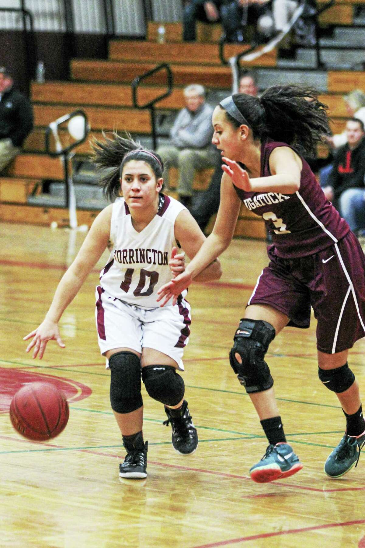 Alexis Tyrrell, guarded here by Naugatuck's Alyana Sosa, had a game-high 14 points for Torrington Tuesday night.