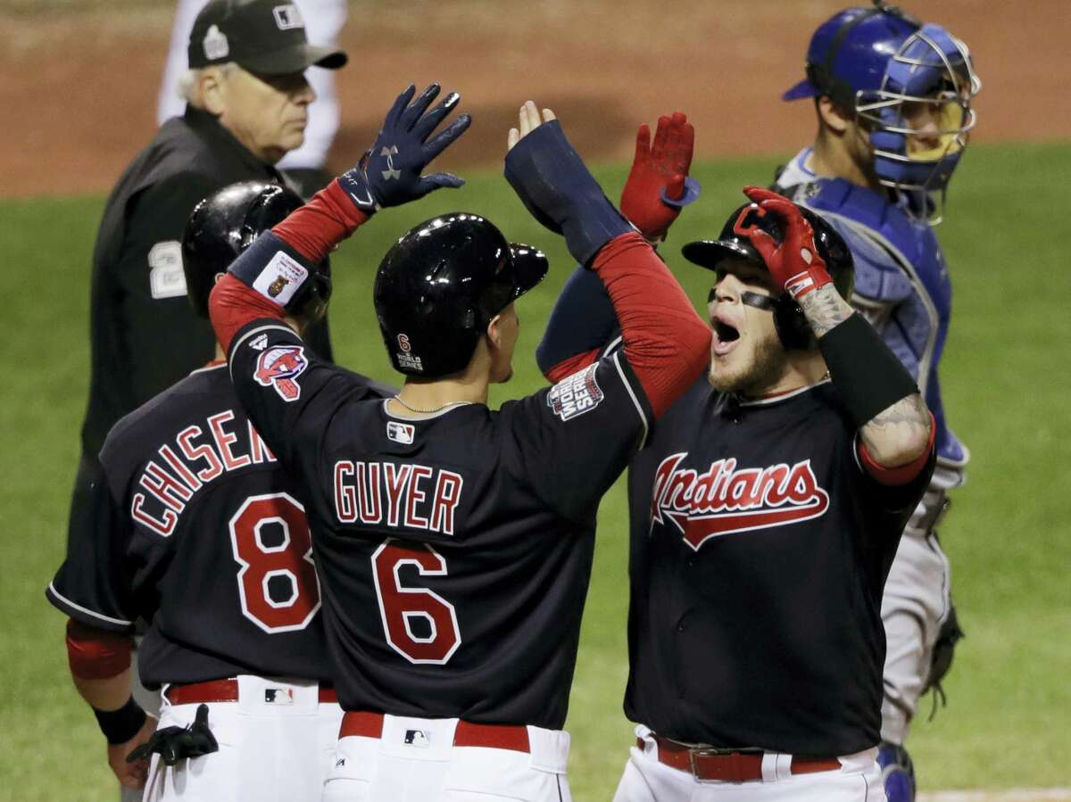 Cleveland Indians' Roberto Perez celebrates with Brandon Guyer (6) and Lonnie Chisenhall (8) after hitting a three-run home run during the eighth inning of Game 1 of the Major League Baseball World Series against the Chicago Cubs on Oct. 25, 2016 in Cleveland.