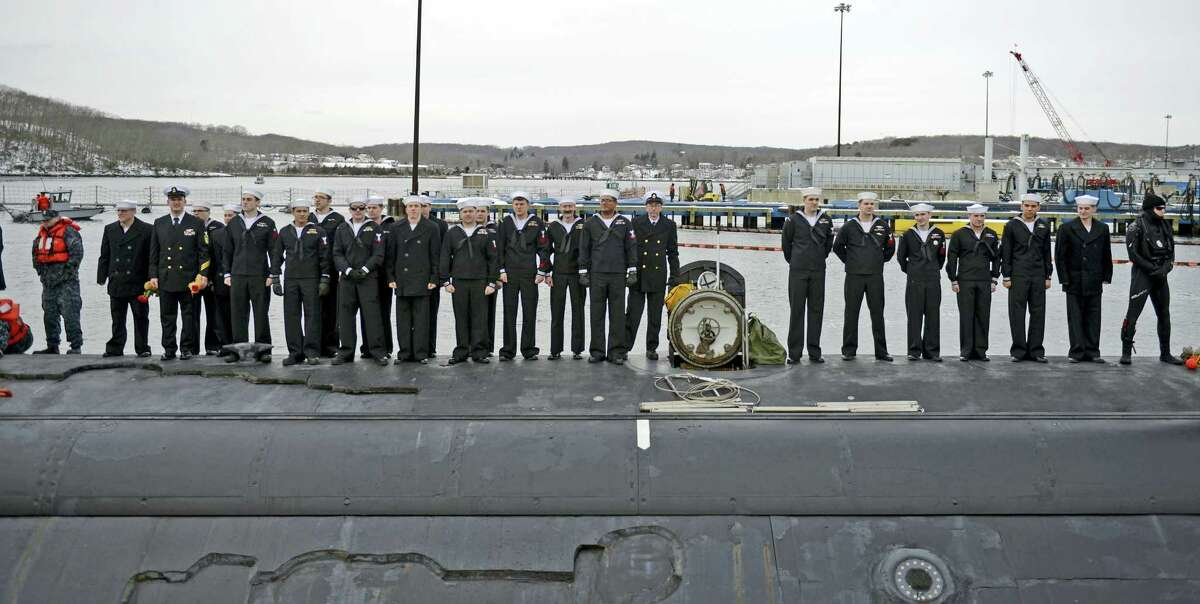 The crew of the U.S. Navy attack submarine USS Missouri (SSN 780) gather on the deck awaiting clearance to go ashore and reunite with their families as the sub returns to the Navy Submarine Bast in Groton, Conn., Friday, Feb. 12, 2016 following a six-month deployment to the European Command area of responsibility. The Missouri, the seventh sub in the Virginia-class, made port calls in Faslane, Scotland, Rota, Spain and Brest, France during the deployment.
