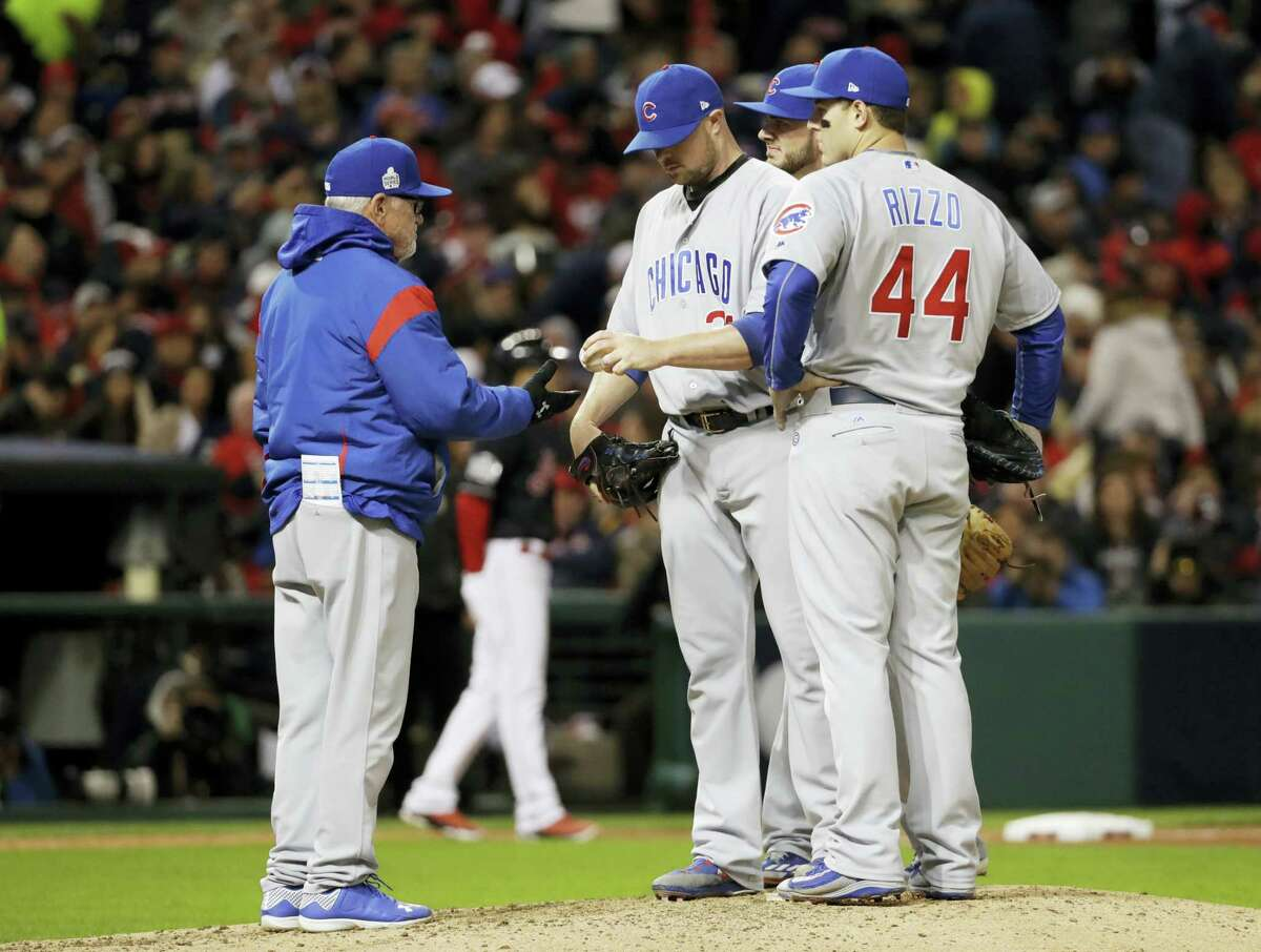 Chicago Cubs manager Joe Maddon takes starting pitcher Jon Lester out of the game during the sixth inning of Game 1 of the Major League Baseball World Series against the Cleveland Indians on Oct. 25, 2016 in Cleveland.
