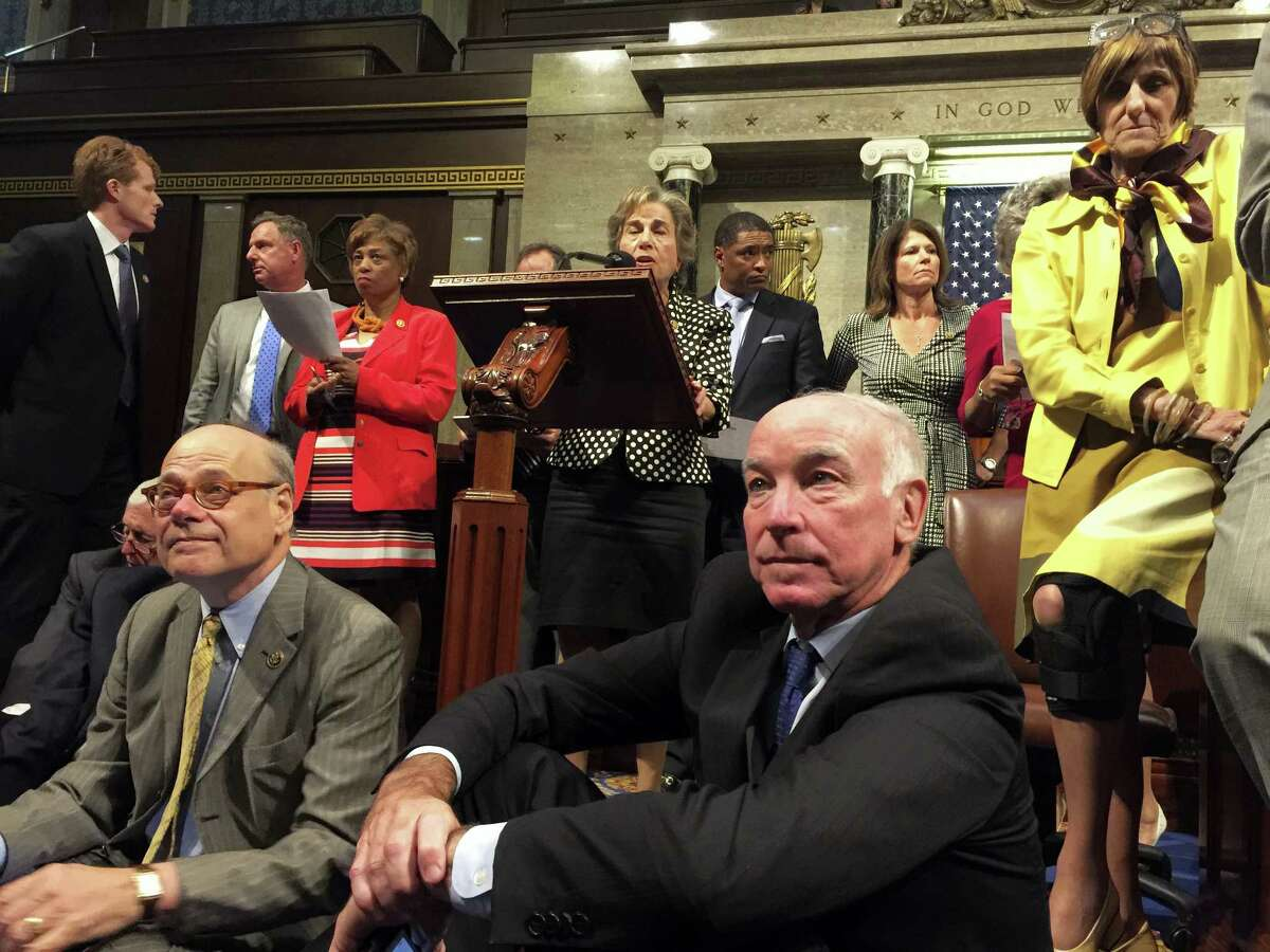 This photo provided by U.S. Rep. Chellie Pingree, D-Maine, shows Democrat members of Congress, including, front row, from left, Rep. Steve Cohen, D-Tenn., Rep. Joe Courtney, D-Conn., and Rep. Rosa DeLauro, D-Conn., participate in sit-down protest seeking a vote on gun control measures Wednesday on the floor of the House on Capitol Hill in Washington.