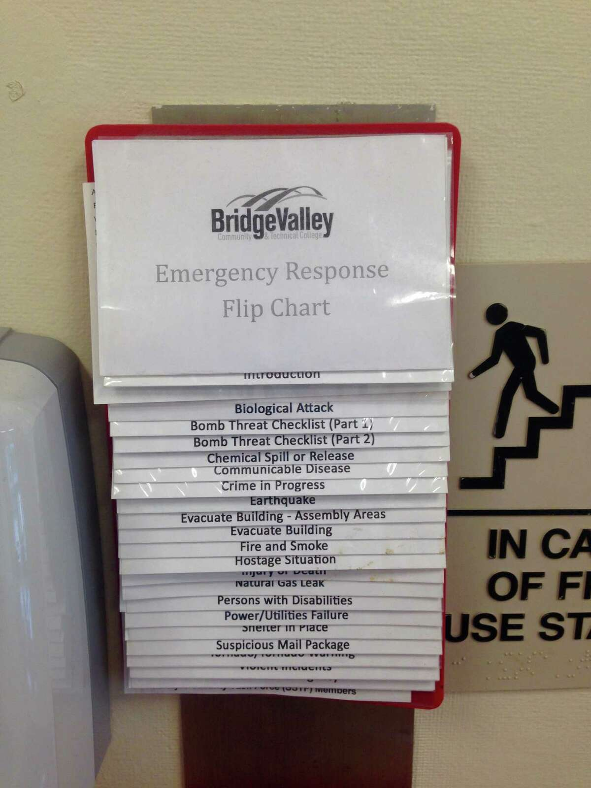 In this photo taken Friday, Oct. 9, 2015, a guide to responding to a campus emergency is displayed at BridgeValley Community and Technical College in Montgomery, W.Va. Two- and four-year college campuses across West Virginia are required to have emergency safety procedures in place, including a plan in case of an active shooter.