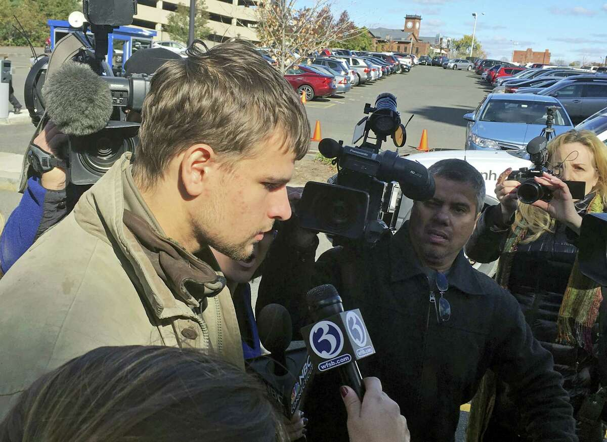 Nathan Carman, speaks to reporters outside Saint Patrick - Saint Anthony Church in Hartford, Conn., Wednesday after a memorial service for his mother, Linda Carman, who was lost at sea. Nathan Carman was rescued by a freighter about 100 miles off the coast of Martha's Vineyard after the boat he and his mother were on sank during the weekend of Sept. 17.