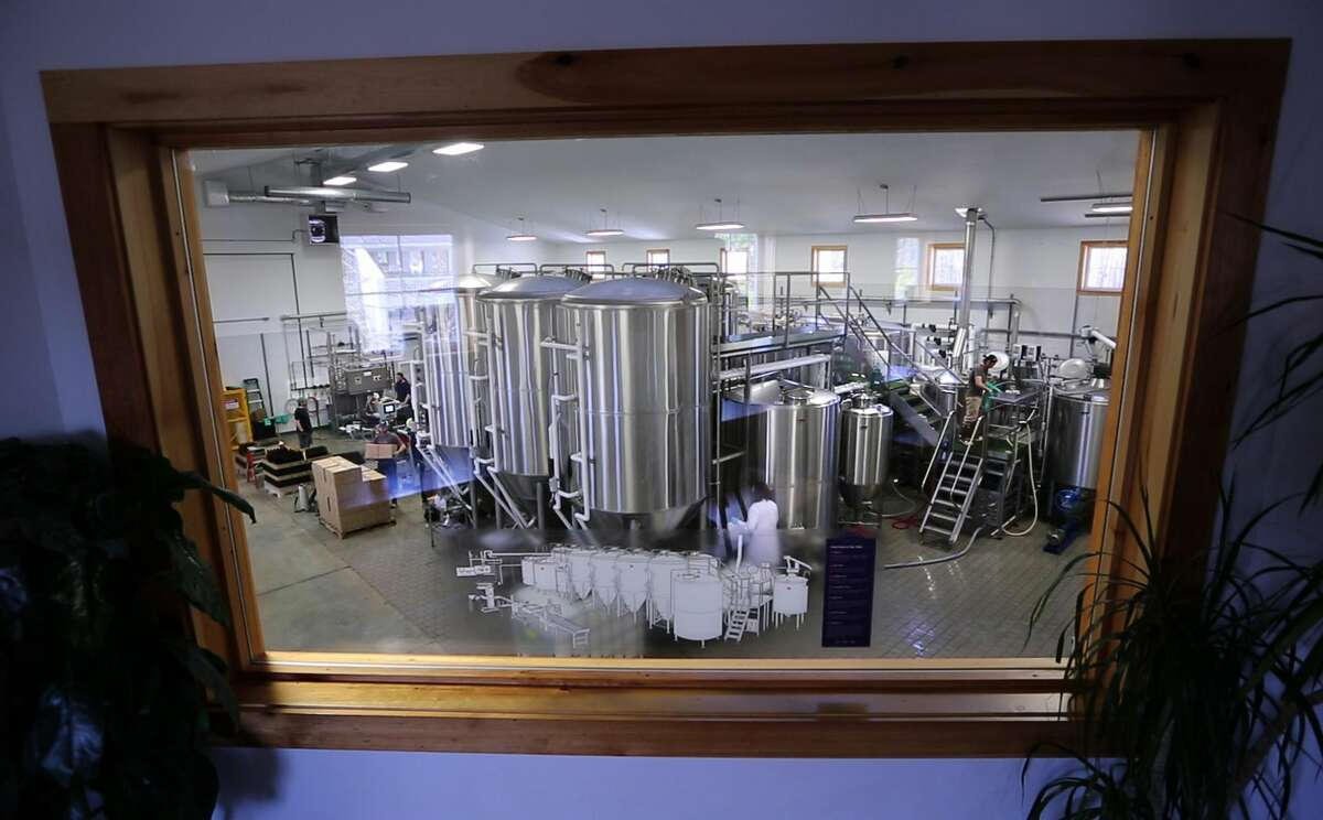 Dan Kleban, a co-owner of the Maine Beer Company, poses in the company's tasting room in Freeport, Maine.