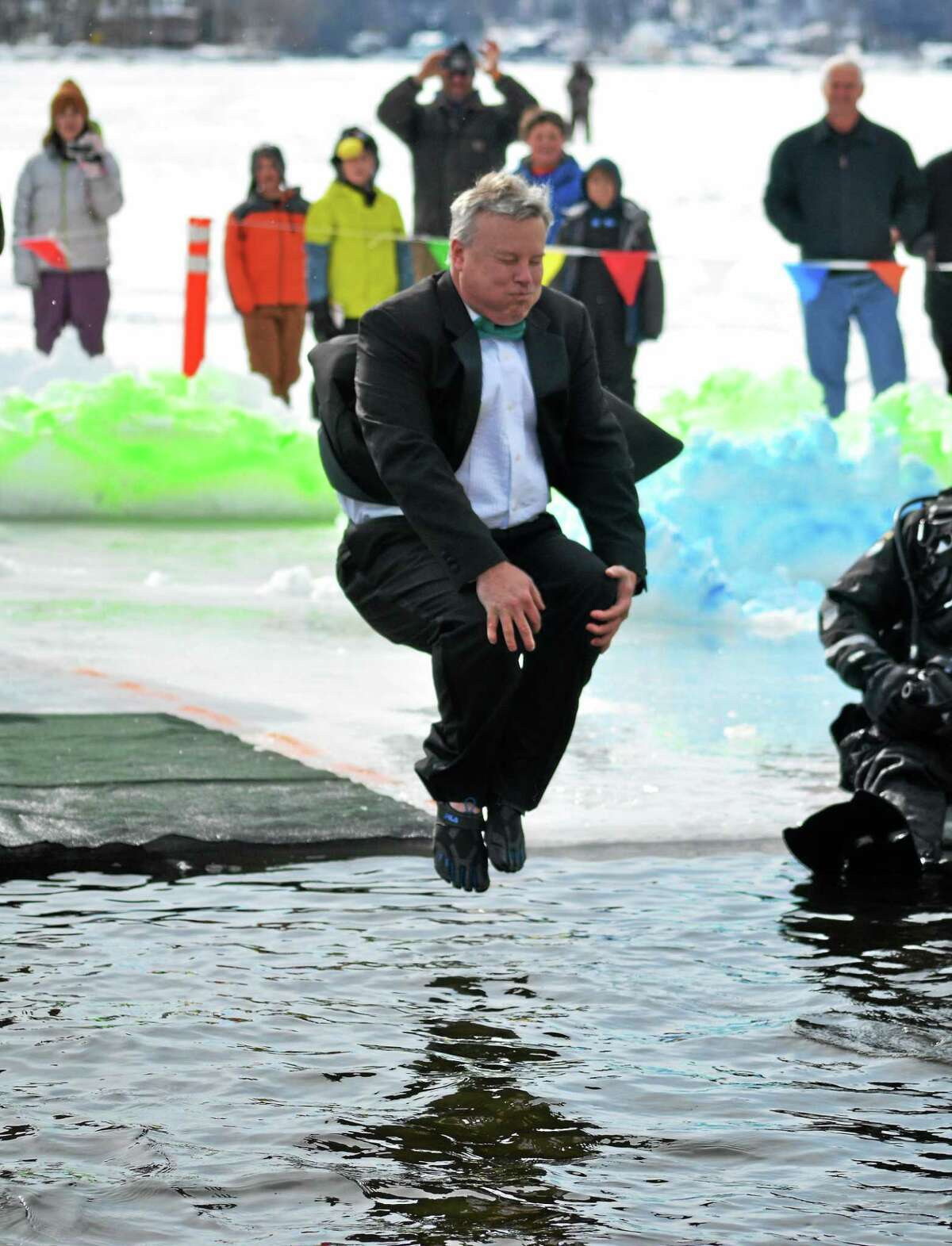 Winsted Town Manager Dale Martin dives into Highland Lake as part of the Penguin Plunge, a fundraiser held annually in Winsted for Special Olympics.