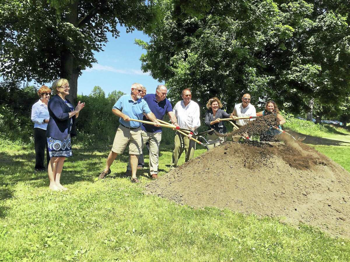 Ben Lambert - The Register Citizen Torrington Mayor Elinor Carbone applauds as city officials and stakeholders break ground on the planned Naugatuck River Greenway trail Wednesday morning.