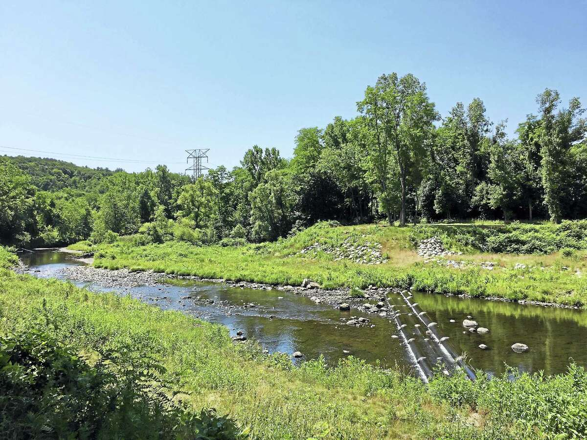 Ben Lambert - The Register CitizenCity officials and stakeholders broke ground on the planned Naugatuck River Greenway trail Wednesday morning.