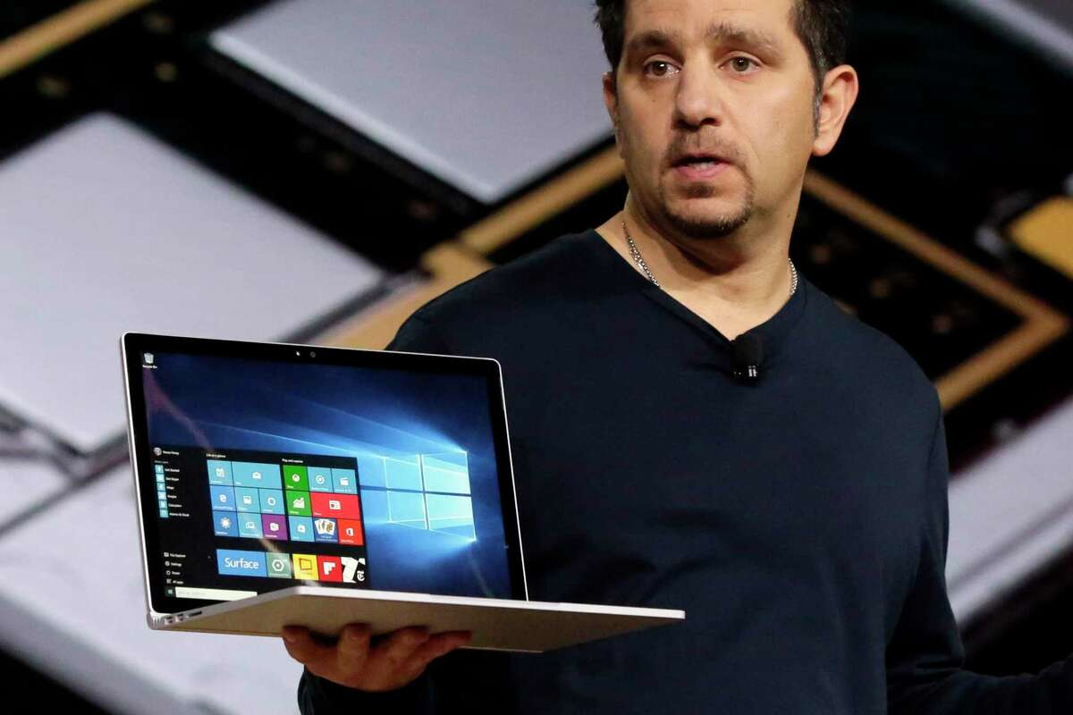 Microsoft vice president for Surface Computing Panos Panay holds a Surface Book laptop during a presentation in New York. Microsoft says it's for scientists, engineers and gamers who need a lot more performance than a tablet.