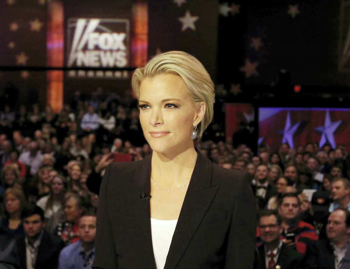 """In this Jan. 28, 2016, file photo, Moderator Megyn Kelly waits for the start of the Republican presidential primary debate in Des Moines, Iowa. Former Republican House Speaker Newt Gingrich told Kelly she is """"fascinated with sex"""" amid criticism of her coverage of sexual misconduct accusations against GOP presidential nominee Donald Trump. The heated exchange came Tuesday, Oct. 25, 2016, on Kelly's program. Kelly responded to Gingrich's comment by saying she's """"not fascinated by sex"""" but is """"fascinated by the protection of women."""""""