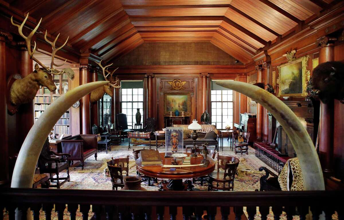 In this June 9, 2015, photo, elk and bison heads along with mementos President Theodore Roosevelt received adorn the North Room, the 26th president's