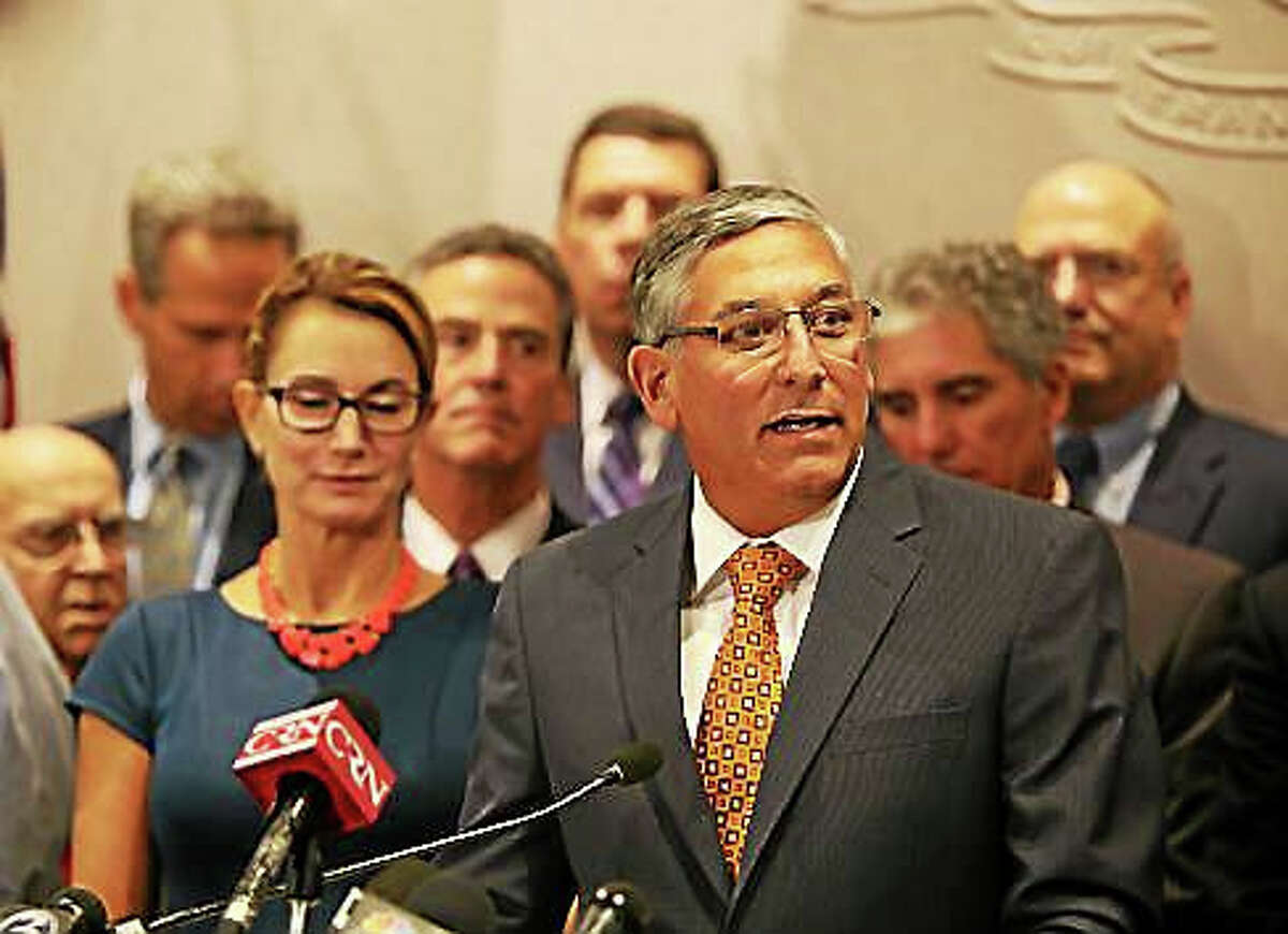 Senate Republican Leader Len Fasano addresses a press conference last month calling for a special session. At left behind him is House Minority Leader Themis Klarides, R-Derby.