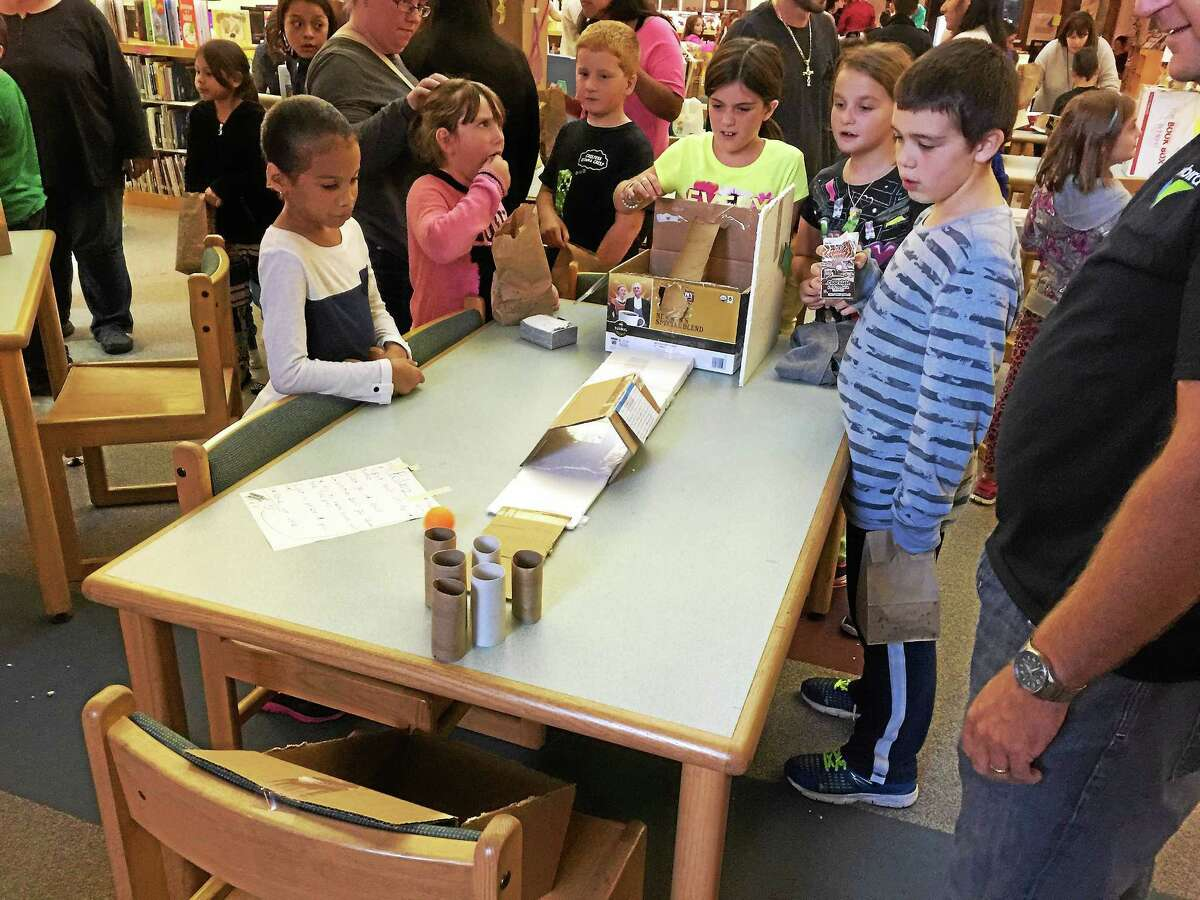 Children and families enjoy the results of the Global Cardboard Challenge Wednesday evening at The Vogel-Wetmore School.