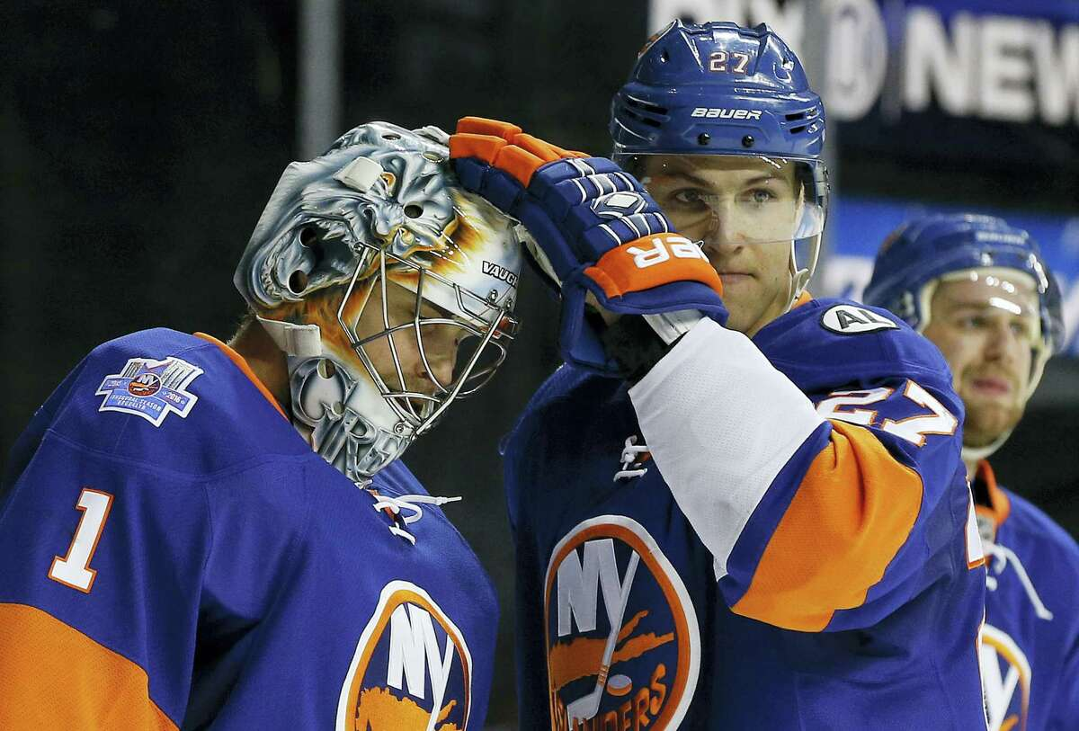New York Islanders center Anders Lee (27) greets goalie Thomas Greiss (1) after the Islanders defeated the Los Angeles Kings 5-2 Thursday.