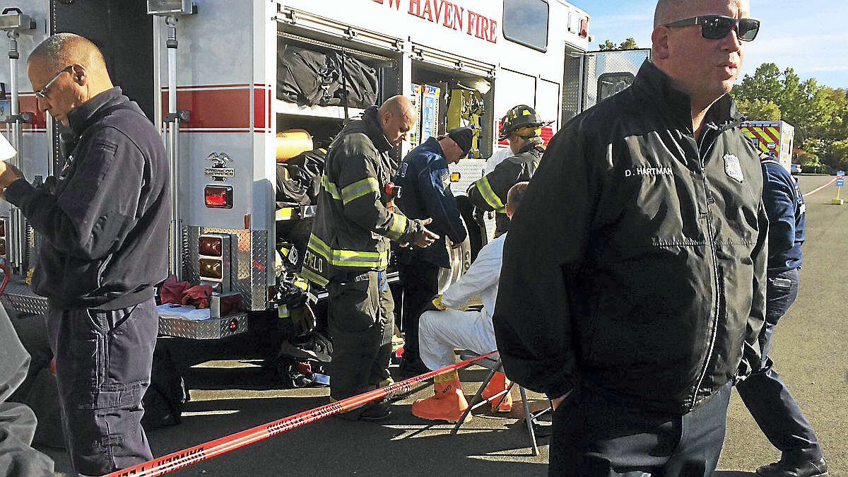 New Haven fire officials said the situation would be an extended operation and a decontamination station was set up if needed.