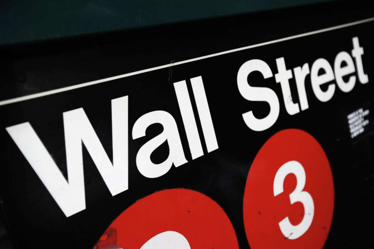 FILE - This Jan. 4, 2010 file photo shows an entrance to a Wall Street subway station in New York. U.S. stocks are moving higher in midday trading Thursday, June 11, 2015, building on a big gain from the day before.