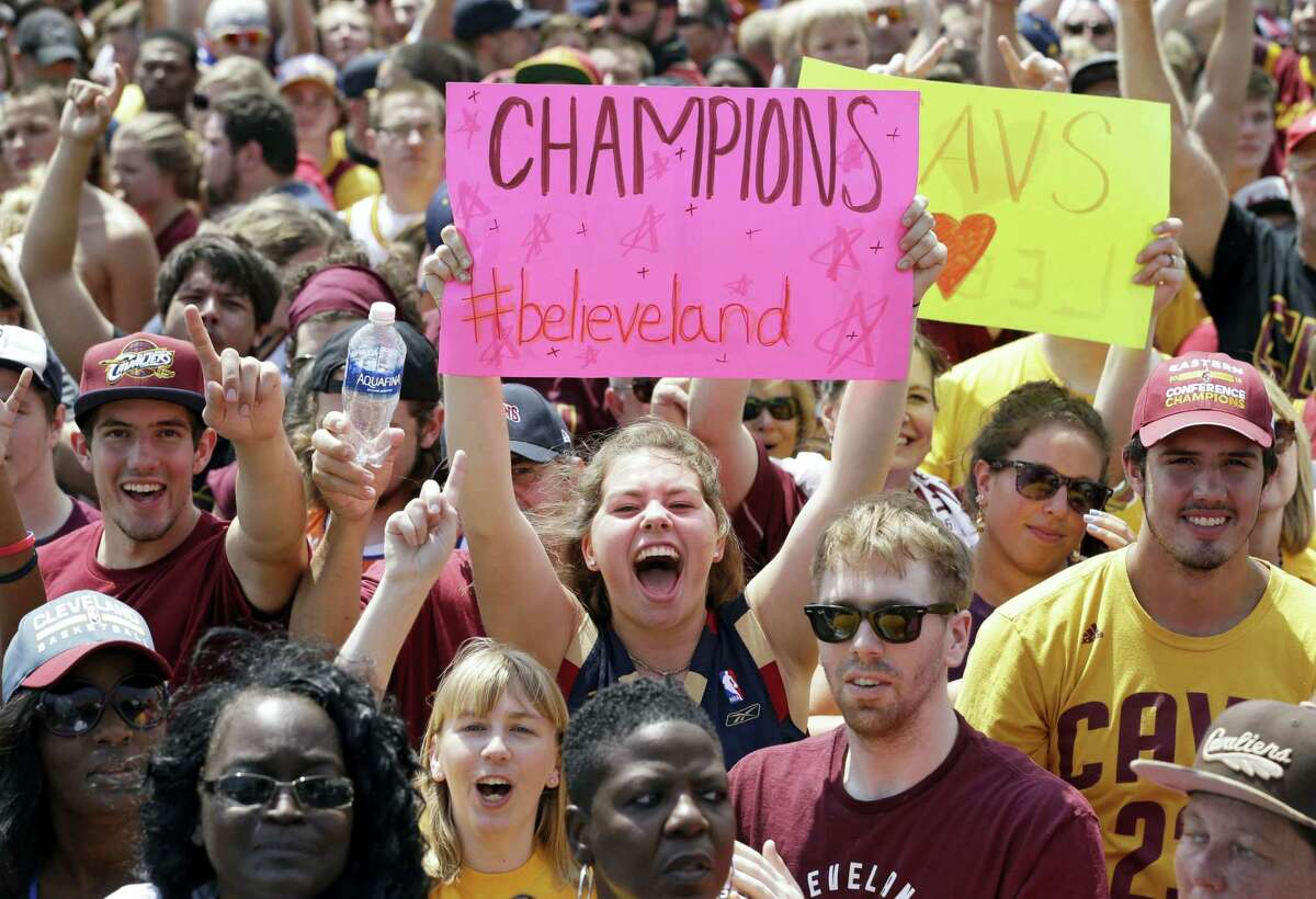Cavaliers fans cheer as they wait for the team's arrival in Clevleand on Monday.