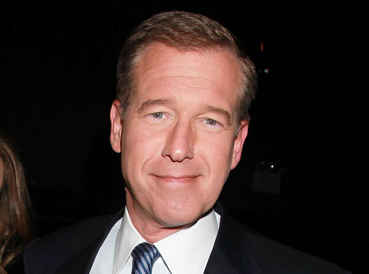 """FILE - This April 4, 2012 file photo shows NBC News' Brian Williams, at the premiere of the HBO original series """"Girls,"""" in New York. NBC says it is suspending Brian Williams as """"Nightly News"""" anchor and managing editor for six months without pay for misleading the public about his experiences covering the Iraq War."""