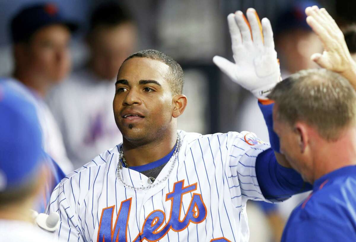 Yoenis Cespedes greets teammates in the dugout after hitting a solo home run during the fourth inning.
