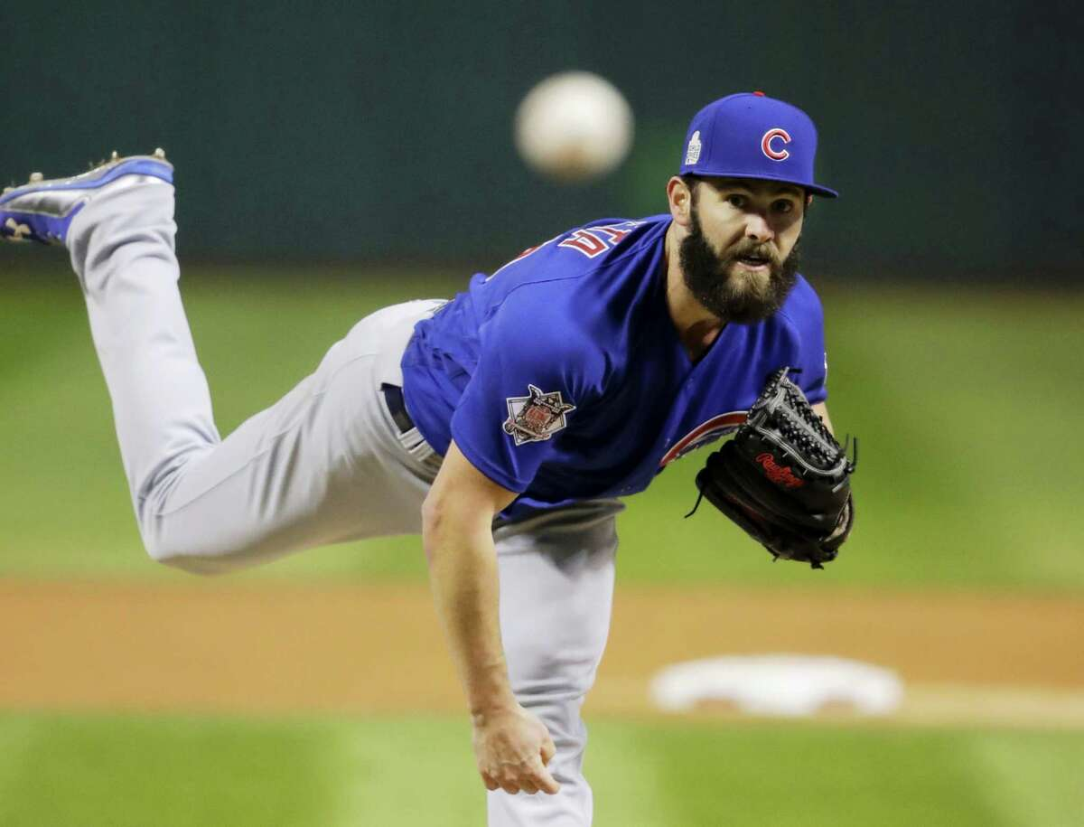Chicago Cubs starting pitcher Jake Arrieta throws during the first inning of Game 2 of the World Series against the Cleveland Indians Wednesday in Cleveland. The Cubs won 5-1 to even the series.