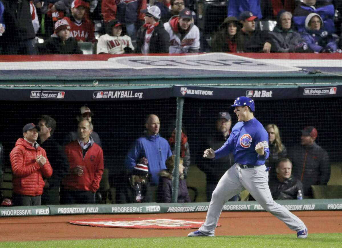 Chicago's Anthony Rizzo celebrates after scoring on a hit by Ben Zobrist during the fifth inning of Game 2.