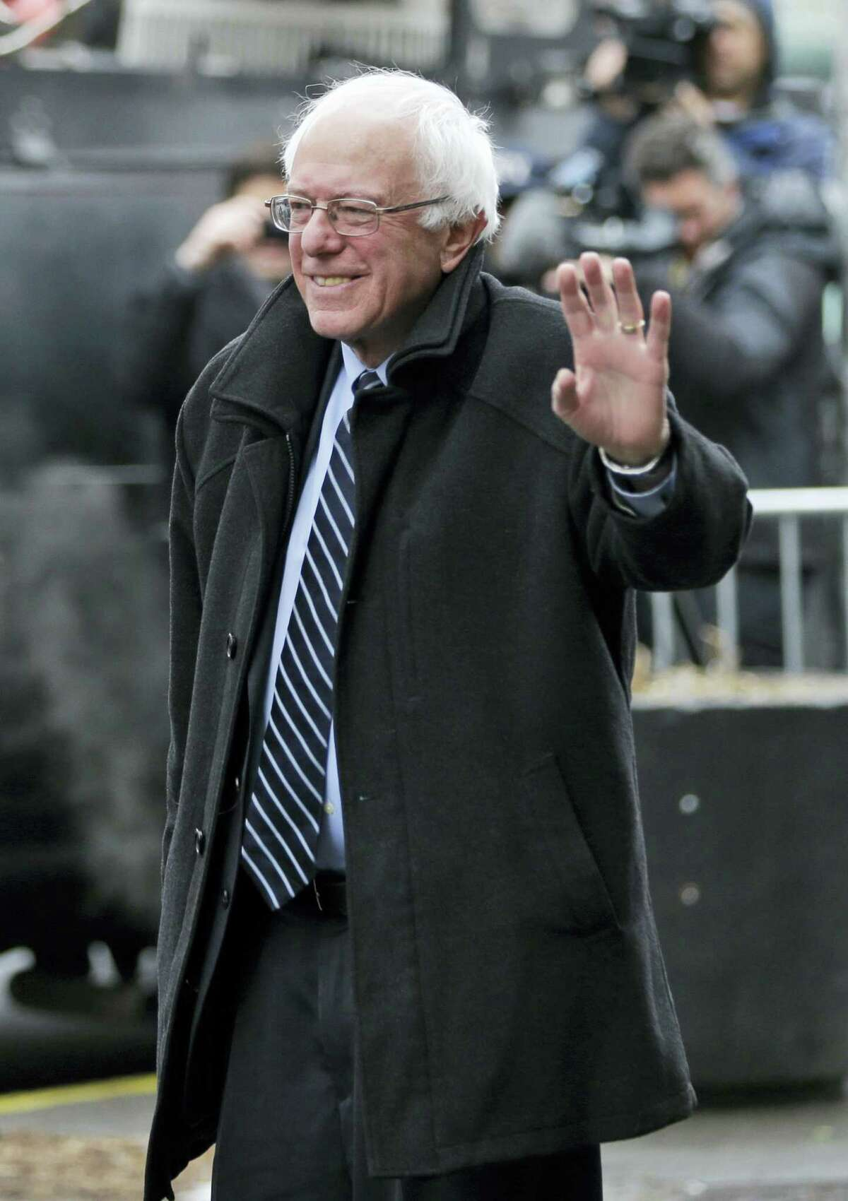 Democratic presidential candidate Sen. Bernie Sanders, I-Vt., waves to media and supporters as he arrives for a breakfast meeting with Rev. Al Sharpton at Sylvia's Restaurant Wednesday in the Harlem neighborhood of New York.
