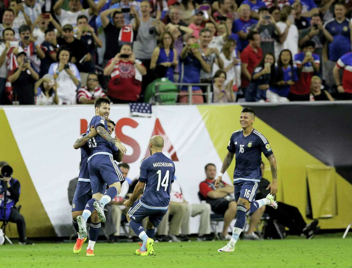 Argentina's Lionel Messi is lifted in celebration during Tuesday's Copa America semifinal in Houston.