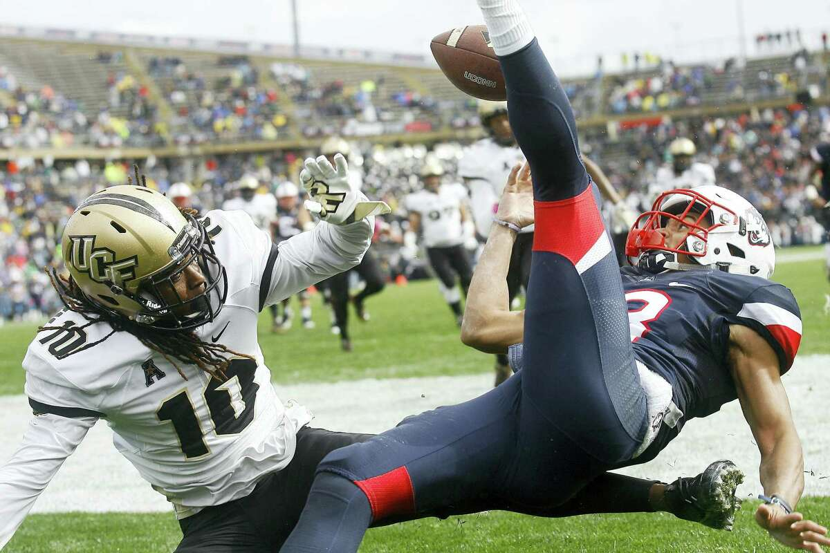 Central Florida defensive back Shaquill Griffin breaks up a pass in the end zone intended for ucONN wide receiver Brian Lemelle during the first quarter Saturday.
