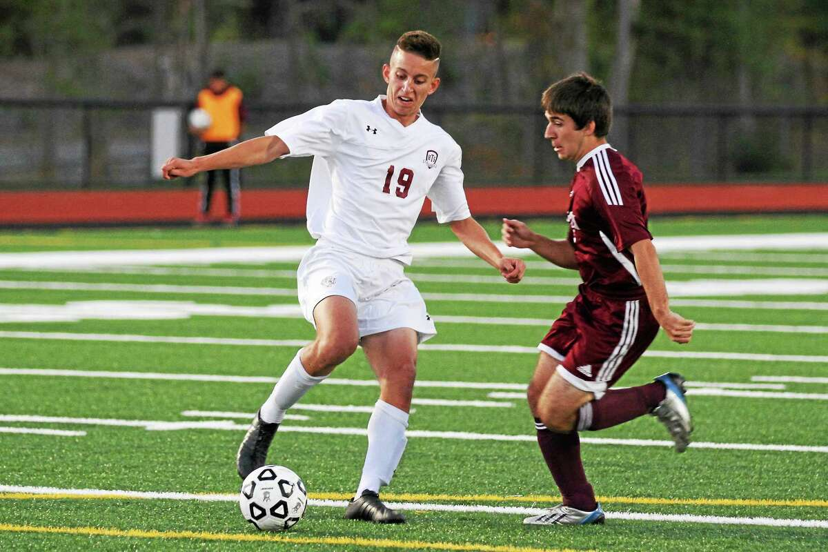 Brandon Stater for Torrington clears the ball from in front of the Raider goal in his team's loss to Naugatuck.