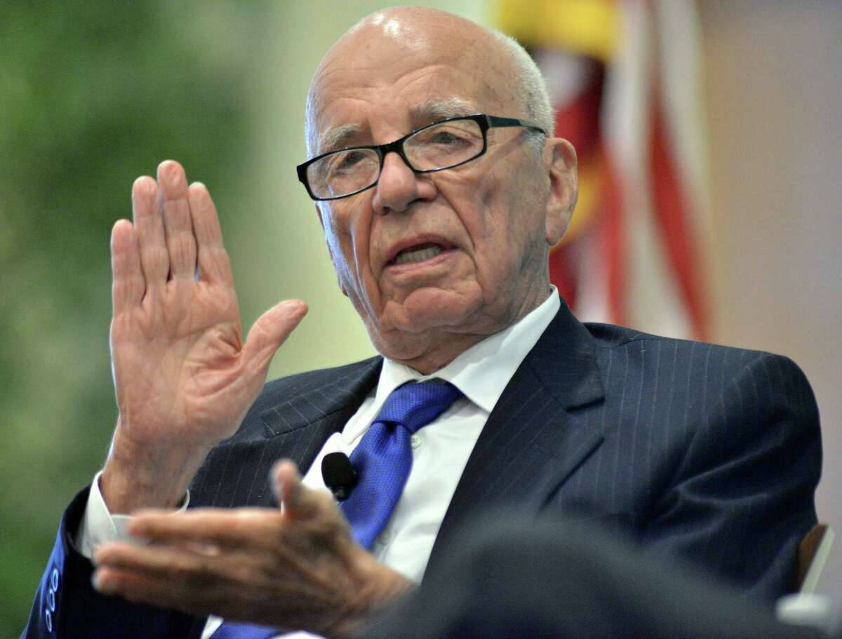 FILE - In this Aug. 14, 2012 file photo, Rupert Murdoch speaks during a forum on The Economics and Politics of Immigration, in Boston. Murdoch, 84, is preparing to hand over the CEO job at Twenty-First Century Fox Inc. to his son, James, according to multiple media reports Thursday, June 11, 2015. (AP Photo/Josh Reynolds, File)