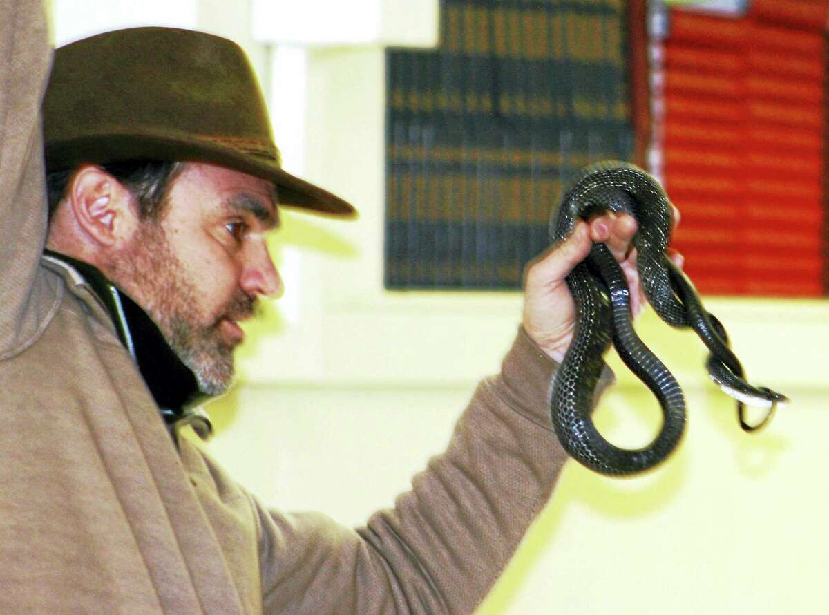 Russ Miller with a snake at a previous demonstration.