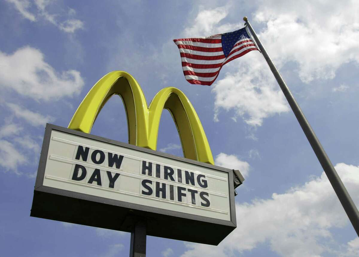 This May 2, 2012, file photo shows a sign advertising job openings outside a McDonalds restaurant in Chesterland, Ohio. The U.S. Labor Department reports on the number of people who applied for unemployment benefits the week ending Sept. 27, 2015 on Thursday, Oct. 1.