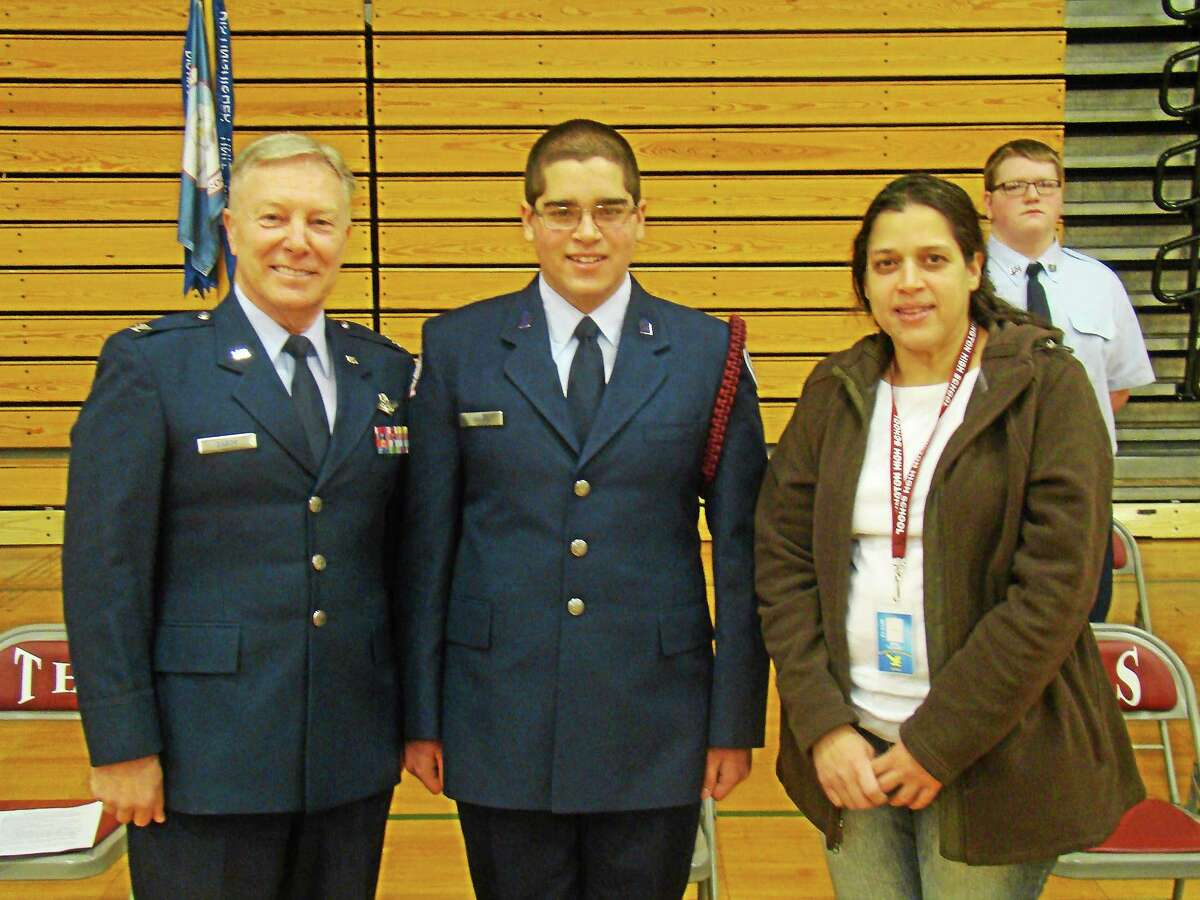Contributed photo Above, from left, are Unit Commander Col. Robert Gabor, Cadet Col. Luigi Ocasio, and Claudia Ocasio, Luigi's mother. In the background is Cadet SSgt Brett Comer. Luigi is the new Cadet Wing Commander of Torrington High School's Air Force JROTC unit, and Cadet Comer is the acting Senior Enlisted Advisor. The picture was taken moments after Luigiís promotion to his new rank of Cadet Col.