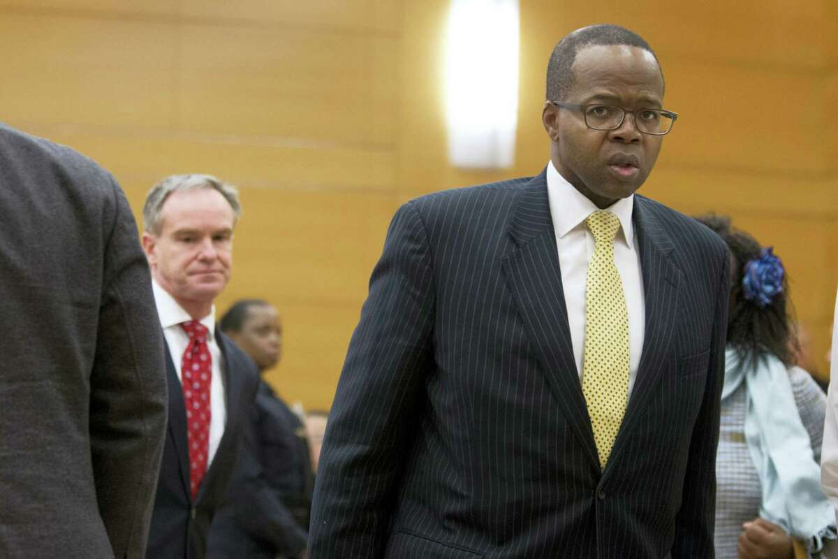 Brooklyn District Attorney Kenneth Thompson, right, is seen in the courtroom after the verdict of police officer Peter Liang's trial on charges in the shooting death of Akai Gurley, Thursday, Feb. 11, 2016 at Brooklyn Supreme court in New York in New York.