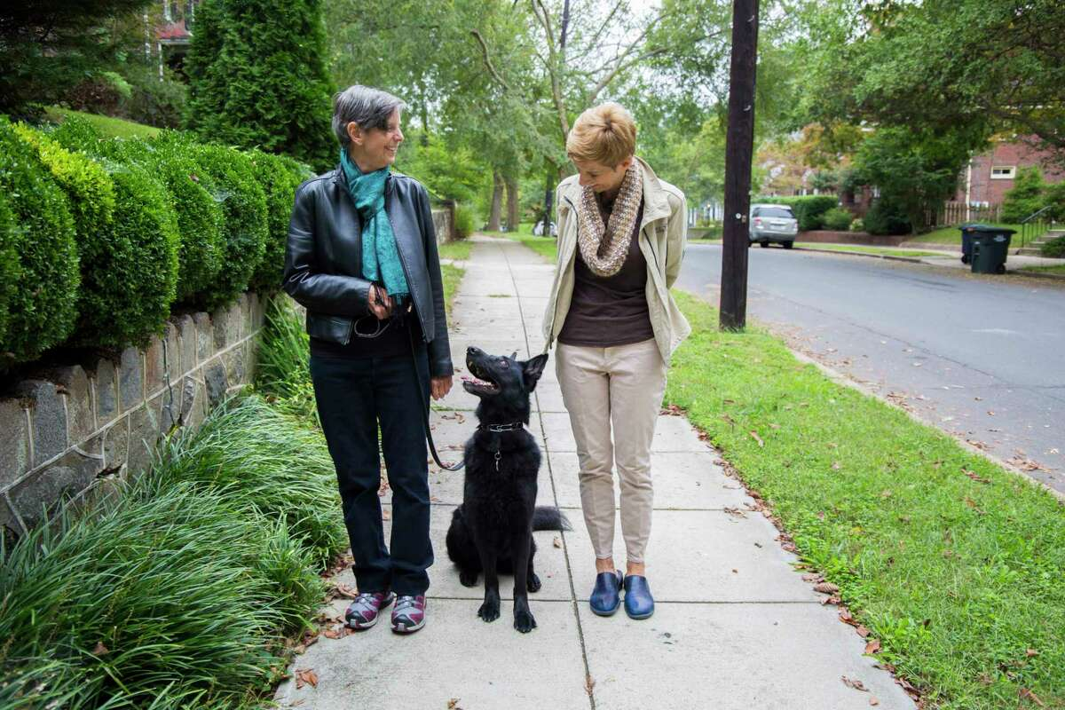 Mary Klein, left, with her wife, Stella Dawson, at their home in Washington, D.C. Klein has advanced ovarian cancer and supports a bill to legalize medical aid in dying in Washington.