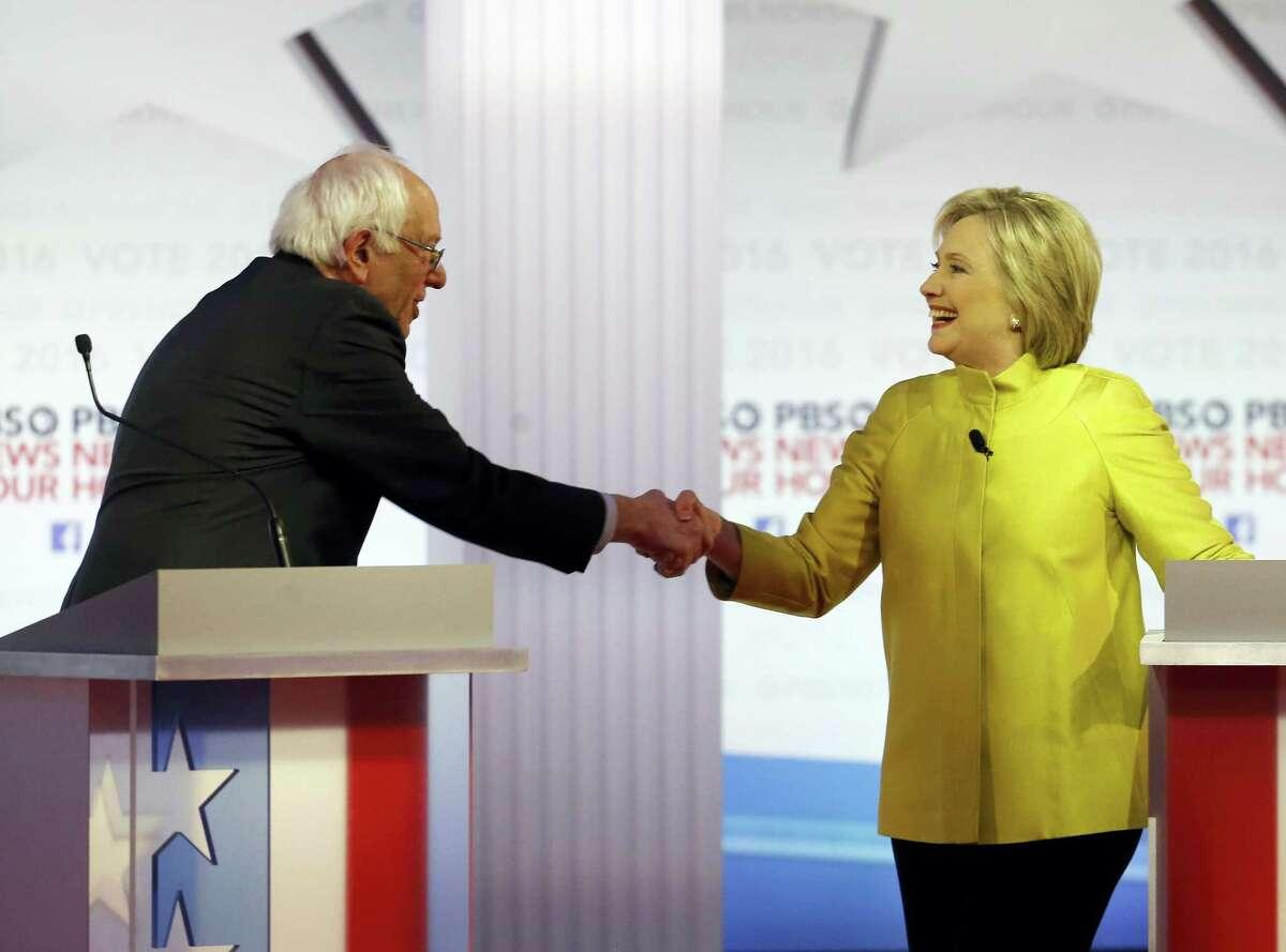 Democratic presidential candidates Sen. Bernie Sanders, I-Vt., and Hillary Clinton shake hands after a Democratic presidential primary debate at the University of Wisconsin-Milwaukee Thursday.