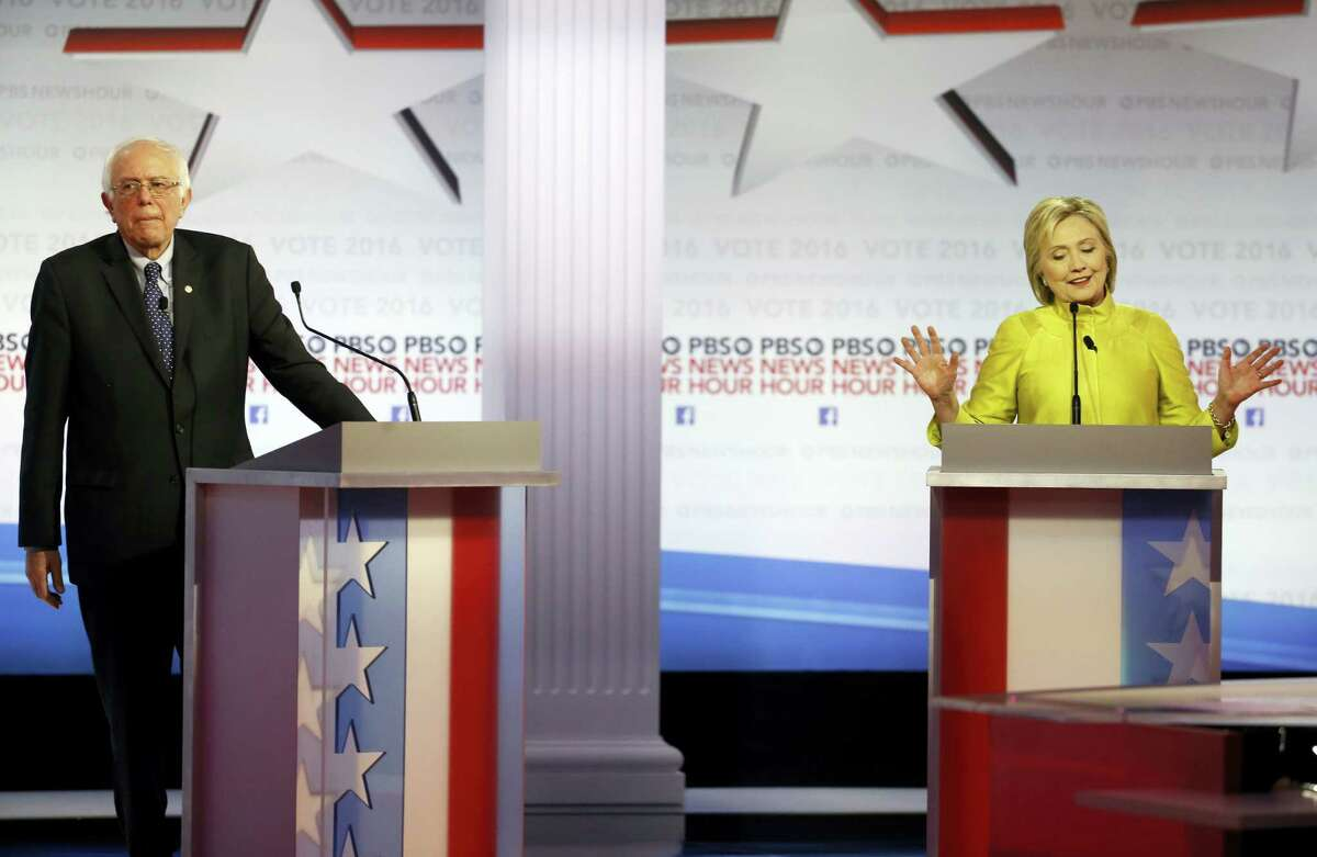 Democratic presidential candidate, Hillary Clinton makes a point as Sen. Bernie Sanders, I-Vt, reacts during a Democratic presidential primary debate at the University of Wisconsin-Milwaukee, Thursday, Feb. 11, 2016, in Milwaukee.