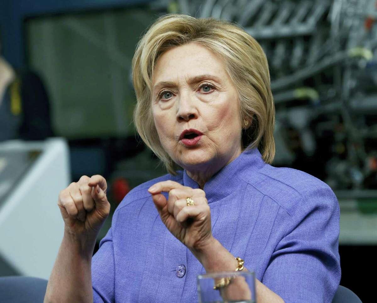 Democratic Presidential candidate Hillary Clinton speaks in Hampton, Va. Clinton said Donald Trump would send the U.S. economy back into recession.