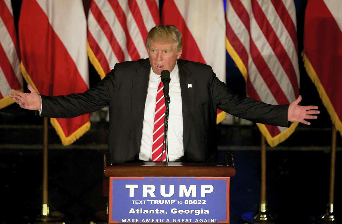 Republican presidential candidate Donald Trump gestures as he speaks during a rally in Atlanta.