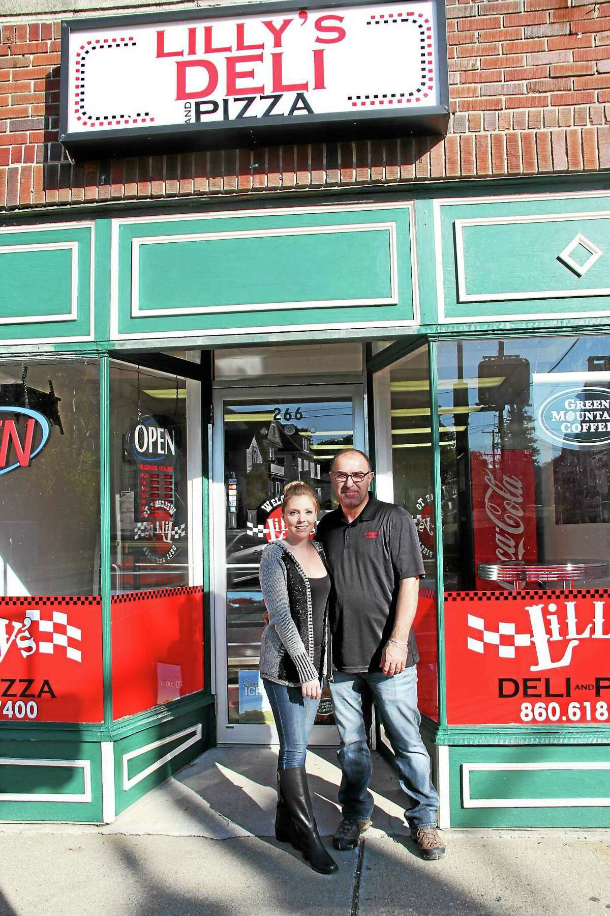 Eddie Odimeh and Rebecca Johnson, owners of Lilly's Deli at 266 Main St. in Torrington, are planning an Oct. 16 opening of the new eatery.