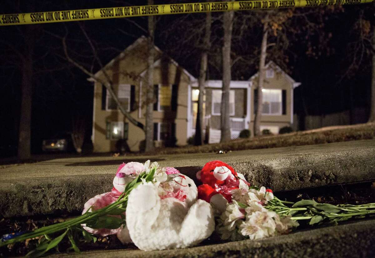 AP Photo/David Goldman Flowers and teddy bears lay on the street outside the home of a shooting scene where authorities say five people are dead, including the gunman, in Douglasville, Ga. on Feb. 7, 2015.