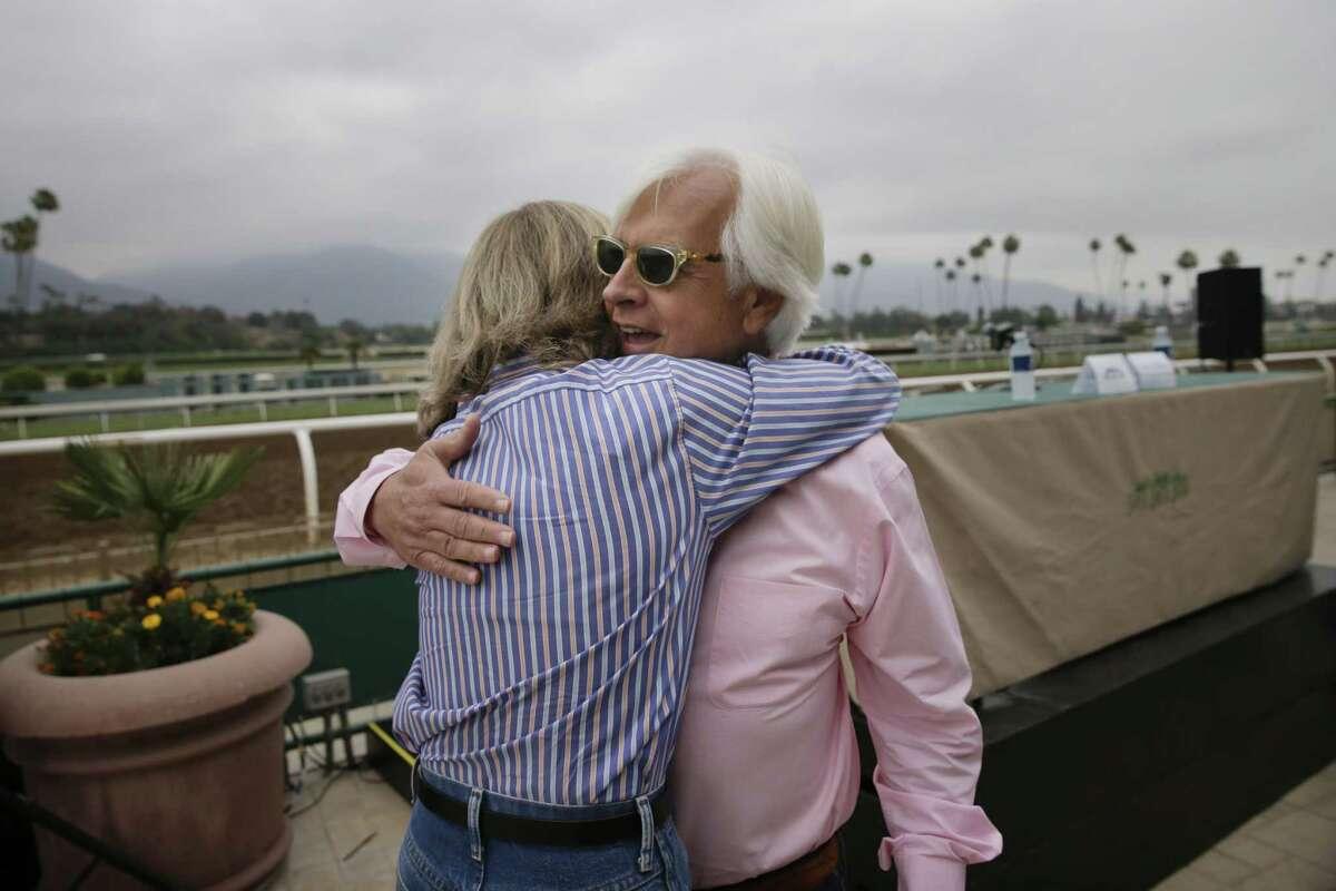Amy Zimmerman, vice president of Santa Anita Park, hugs Bob Baffert, the trainer for Triple Crown-winning horse American Pharoah, at a news conference Wednesday in Arcadia, Calif.