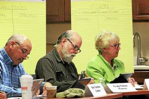 Local leaders: Bob Valentine of Goshen, Craig Nelson of Warren and Sue Dyer of Norfolk, write down some of their challenges and visions about regional transportation.