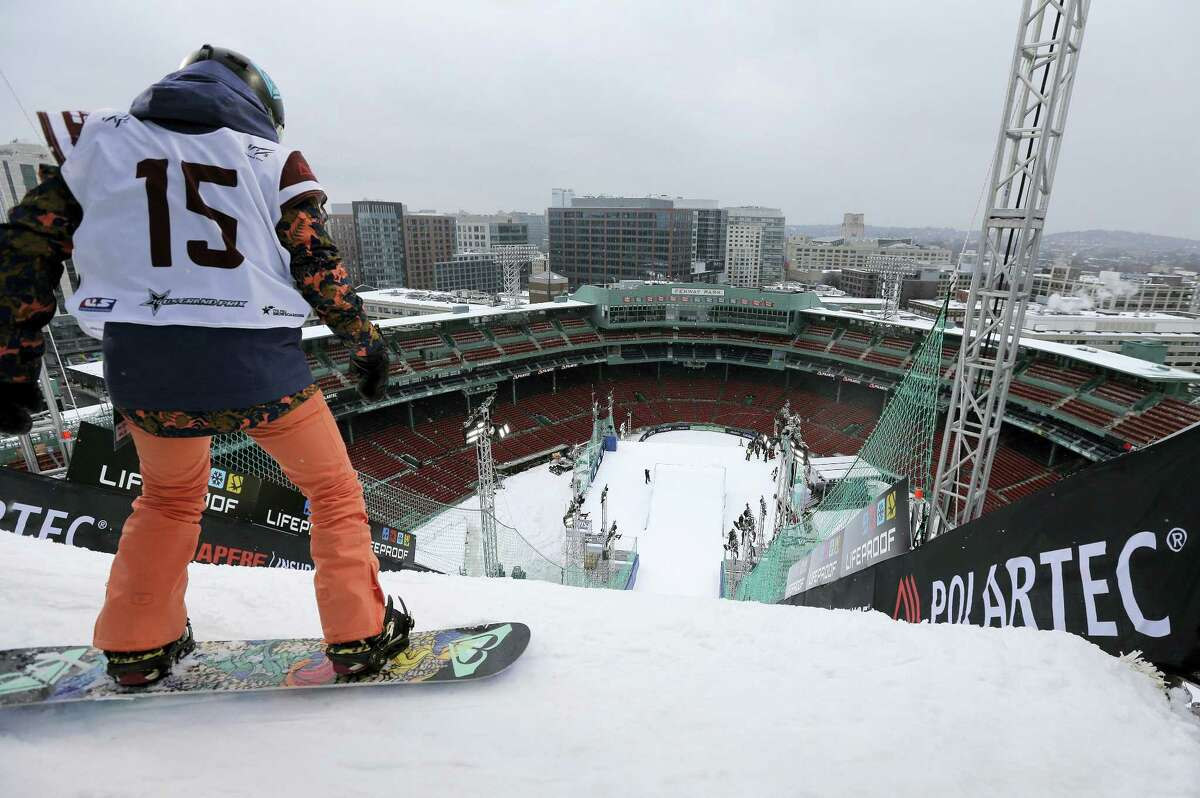 Snowboarder Katie Ormerod prepares to make a practice jump on Wednesday.