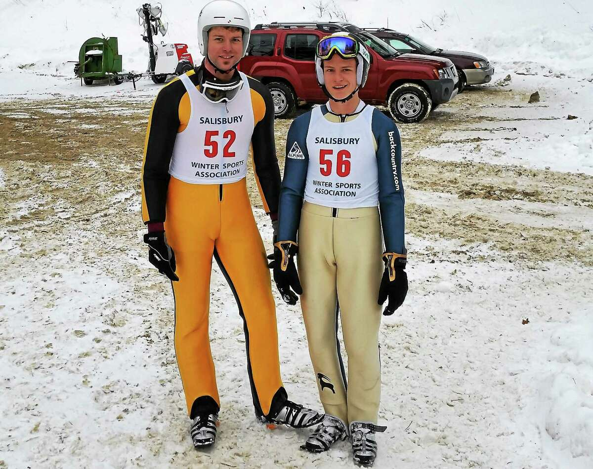 Ski jump competitors Joshua Flanders, 26, of Lebanon, New Hampshire, and Andrew Kazal, 17, of Hanover, Massachusetts, take a break at the 89th annual Jumpfest Winter Festival on Satre Hill in Salisbury on Sunday.