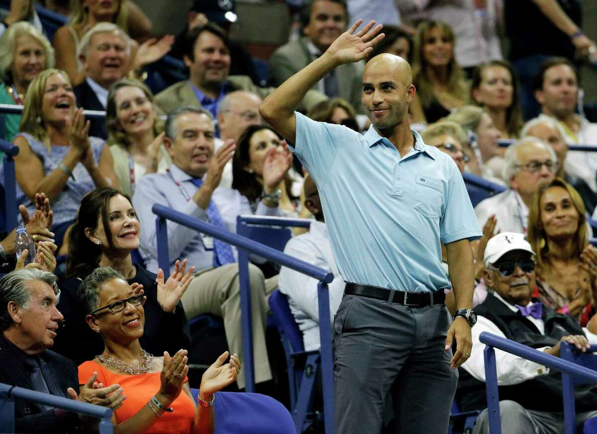 In this Sept. 11 file photo, former tennis pro James Blake acknowledges applause during a semifinal match between Roger Federer and Stan Wawrinka at the U.S. Open in New York.