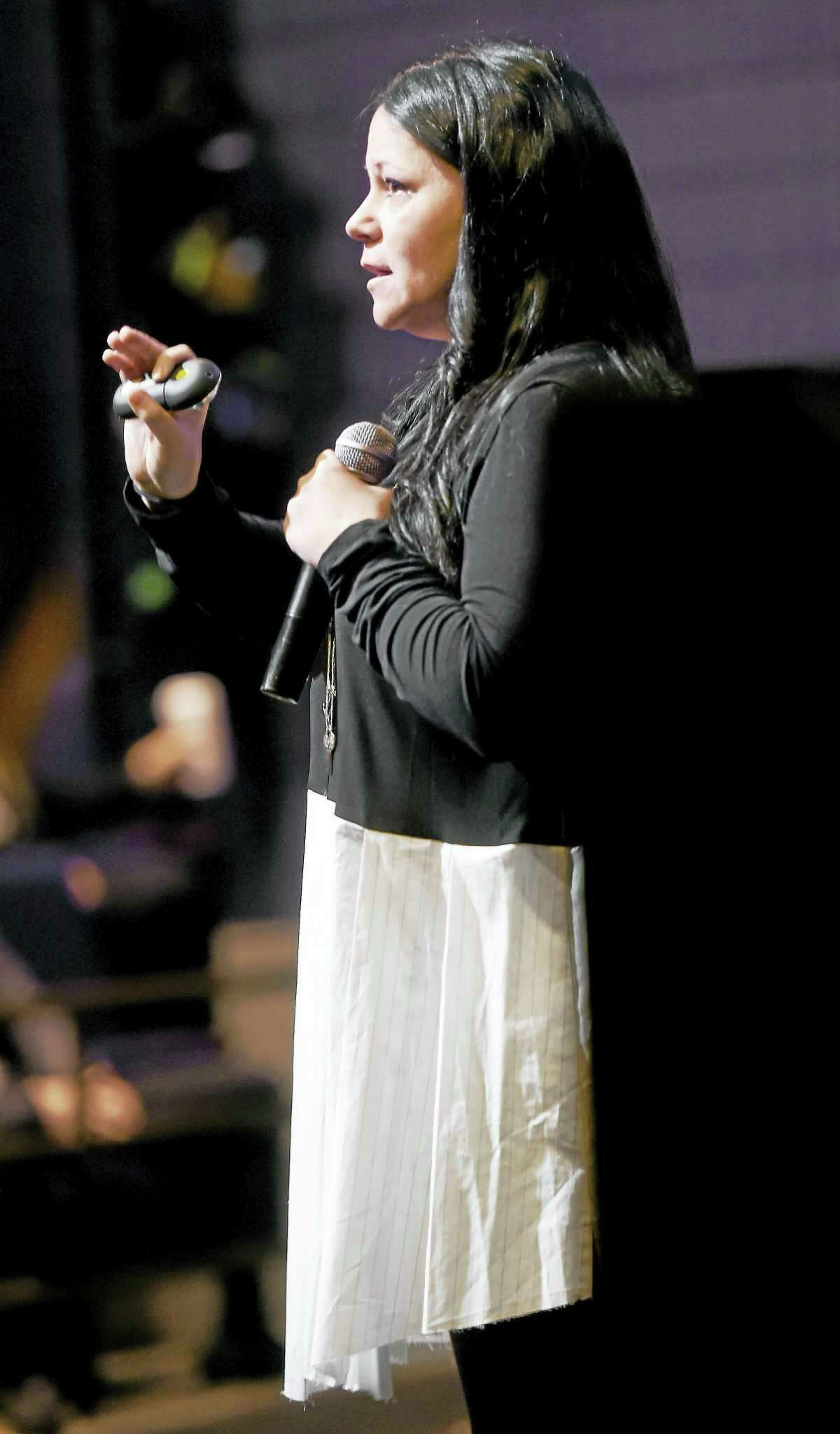 (Arnold Gold-New Haven Register) Human trafficking survivor Timea Nagy of Canada speaks at the 25th Annual Arnold Markle Symposium at the University of New Haven on 10/25/2016.