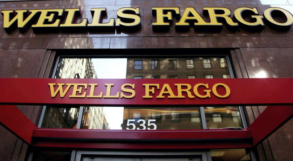 In this file photo, a Wells Fargo sign is displayed at a branch in New York.