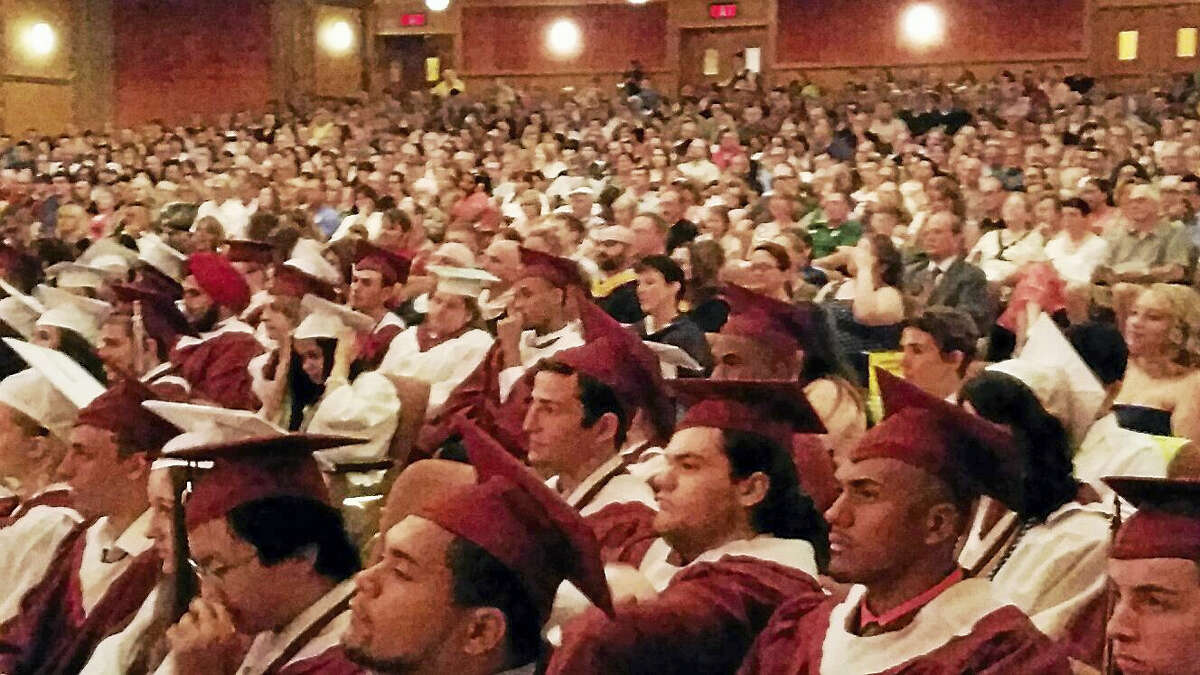 Students participate in the graduation ceremonies for Torrington High School at the Warner Theatre on Sunday evening.