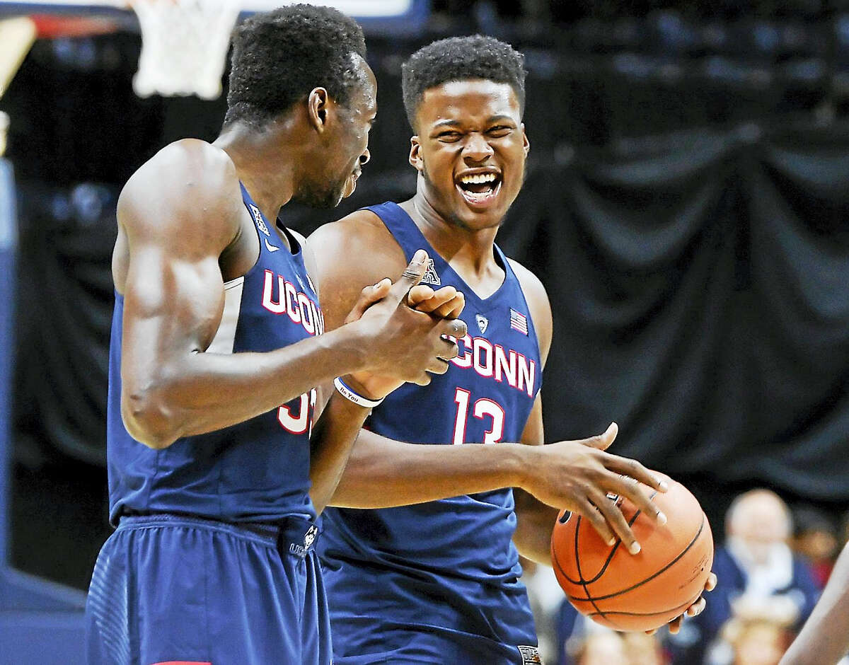 UConn's Amida Brimah and Steve Enoch laugh during First Night in Storrs earlier this month.